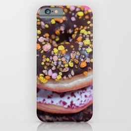Macro shot of stack of donuts over pink background iPhone Case