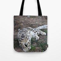 snow leopard Tote Bags featuring Snow Leopard by Kaleena Kollmeier