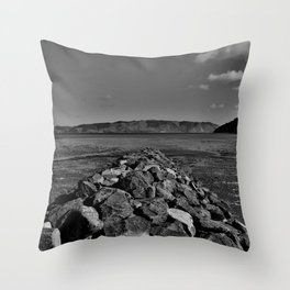 Sea wall of rocks and stones Throw Pillow