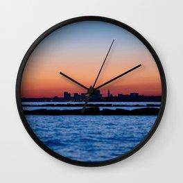 sunset water city buildings silhouettes dark Wall Clock