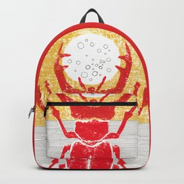 Red stag facing a golden sky Backpack