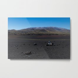 Masked man resting on the volcano Metal Print
