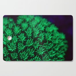 Fluorescent coral polyps reaching toward infinity Cutting Board