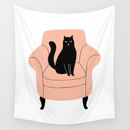 black cat on a chair Wall Tapestry