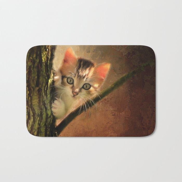 Little cute kitten on a tree Bath Mat