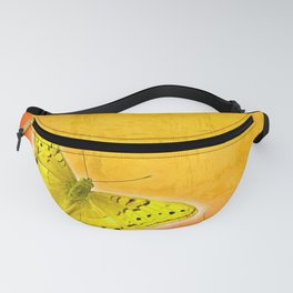 Glowing yellow butterfly on vibrant textured background Fanny Pack