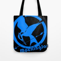 mockingjay Tote Bags featuring MockingJay by Marc Koster