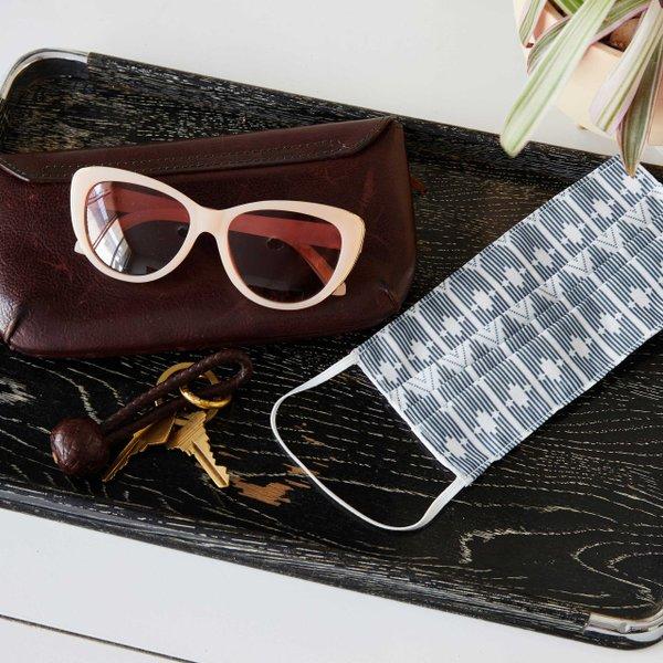 blue boho face mask next to a pair of sunglasses