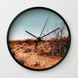 Desert and wind turbine with blue sky at Kern County California USA Wall Clock