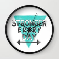 crossfit Wall Clocks featuring Stronger Every Day (barbell) by Lionheart Art