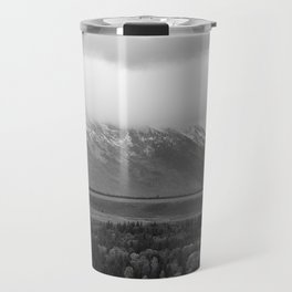 Storm or a snow capped mountain Travel Mug
