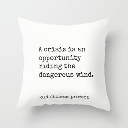 A crisis is an opportunity riding the dangerous wind. Throw Pillow