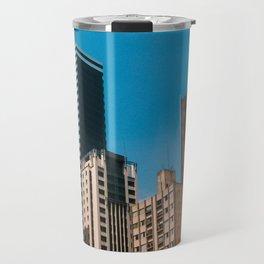 Buildings with blue sky Travel Mug