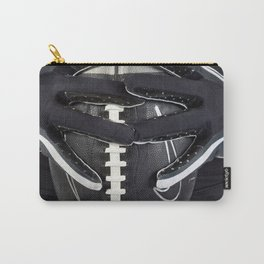 Black gloved hands holding a black American Football Carry-All Pouch