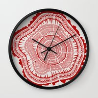 tree rings Wall Clocks featuring Red Tree Rings by Cat Coquillette