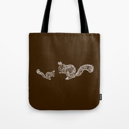 the family squirrel. mother squirrel teaching her youngster to chew the nut Tote Bag