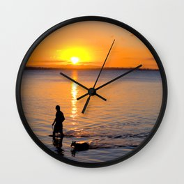Wading in the Sunset Wall Clock