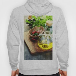 fresh  herbs, olive oil and vegetables on cutting board Hoody