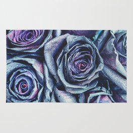 Macro photography of purple - neon roses with raindrops. Fantasy and magic concept. Selective focus. Rug