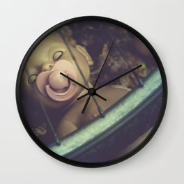 Strange, dark doll with pacifier - vintage, film colors Wall Clock