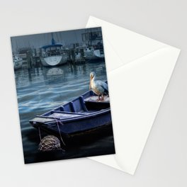 Pelican on a Small Boat in a Coastal Harbor Stationery Cards