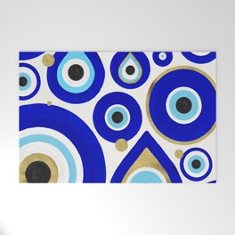 Evil Eye Charms on White Welcome Mat