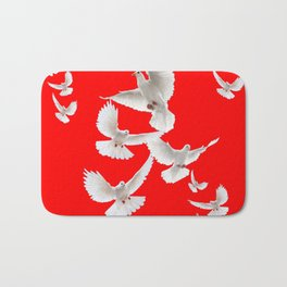 FLOCK OF WHITE PEACE DOVES ON RED COLOR Bath Mat