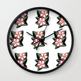 Large pink tropical flowers on black and green leaves Wall Clock