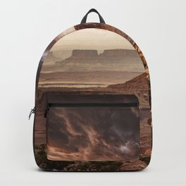 dramatic sky in moab Backpack
