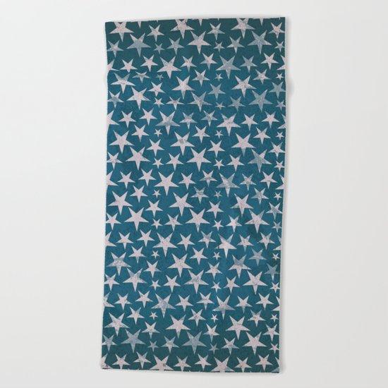 White stars on grunge textured blue background Beach Towel