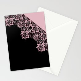 Pink lace on a black background . Stationery Cards