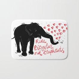 Ride bicycles not elephants. Black elephant, Red text Bath Mat