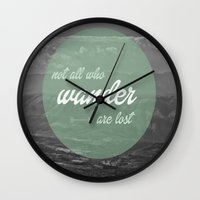 not all who wander Wall Clocks featuring not all those who wander by AnnaGo