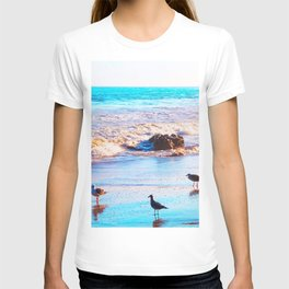 seagull bird on the sandy beach with blue wave water in summer T-shirt