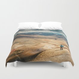 Man front of the mountain Duvet Cover