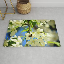 A bee and apple blossoms Rug