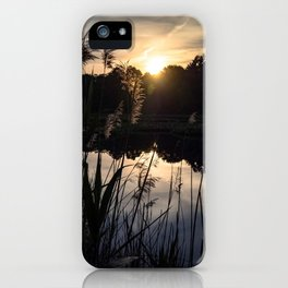 The Sun rising above the Marshlands iPhone Case