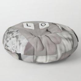 Love- a couple holding tiles spelling Floor Pillow