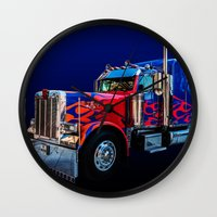 optimus prime Wall Clocks featuring Optimus Prime Blue by Steve Purnell