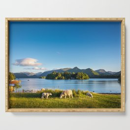 Sheep grazing on the lush shores of Lake Derwentwater, England Serving Tray