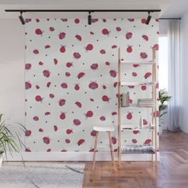 Red ladybugs staying around and purple dots over light yellow background Wall Mural