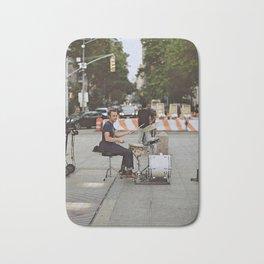 Drummer in the Park Bath Mat