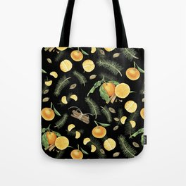 Tangerines and spices on black background Tote Bag