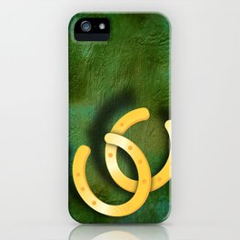 Lucky horseshoes on a textured green background iPhone Case