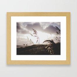 Sun set at the beach Framed Art Print