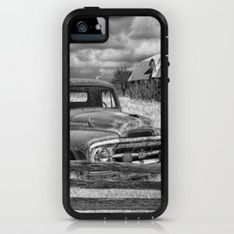 Black and White of Rusted International Harvester Pickup Truck behind wooden fence with Red Barn in iPhone Case