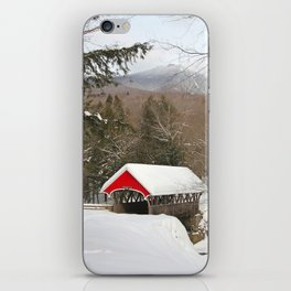 Red covered bridge in snowy landscape iPhone Skin