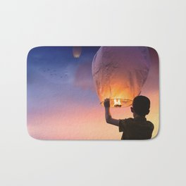 Boy Releasing Chinese Lanterns to the Sky Bath Mat
