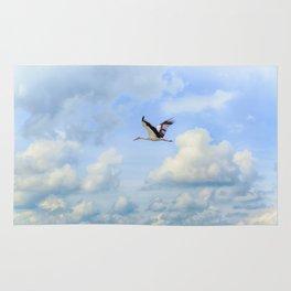 Flying stork Rug