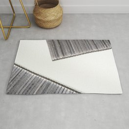 Abstract image composed of two office staples slats Rug